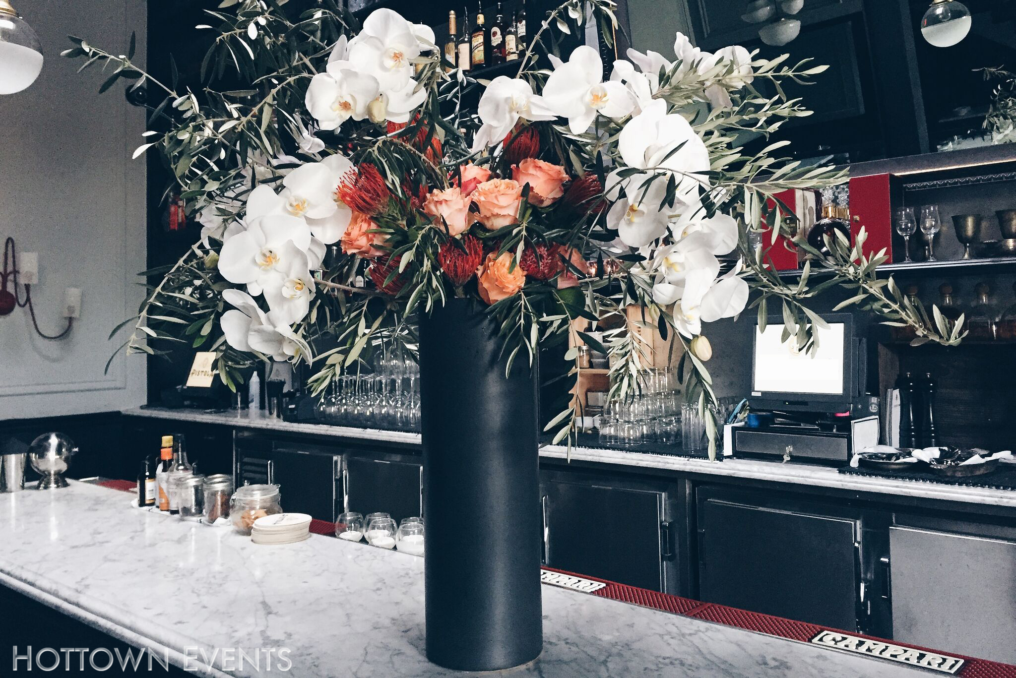 <h5>Large Orchid & Roses Bar top arrangement</h5>