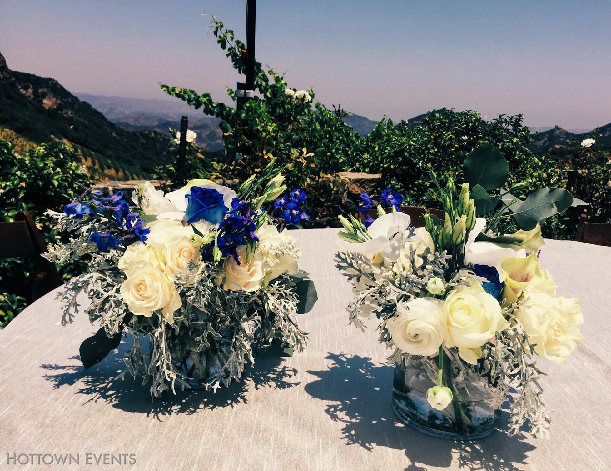 <h5>Multi colour floral table top arrangement</h5>